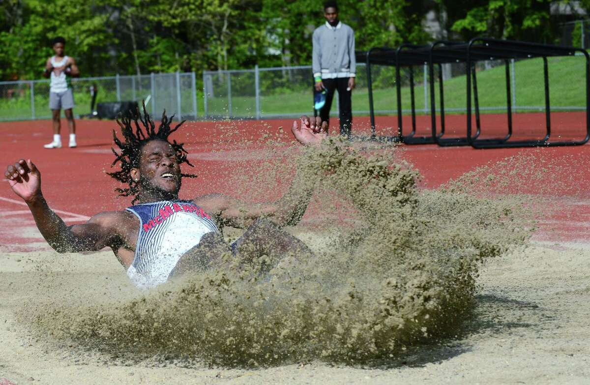 Senator Justin Forde competes in the long jump as the Brien McMahon High School Senators take on the Norwalk High Schools Bears in the intra-city track meet Wednesday, May 15, 2019, at Norwalk High School in Norwalk, Conn.