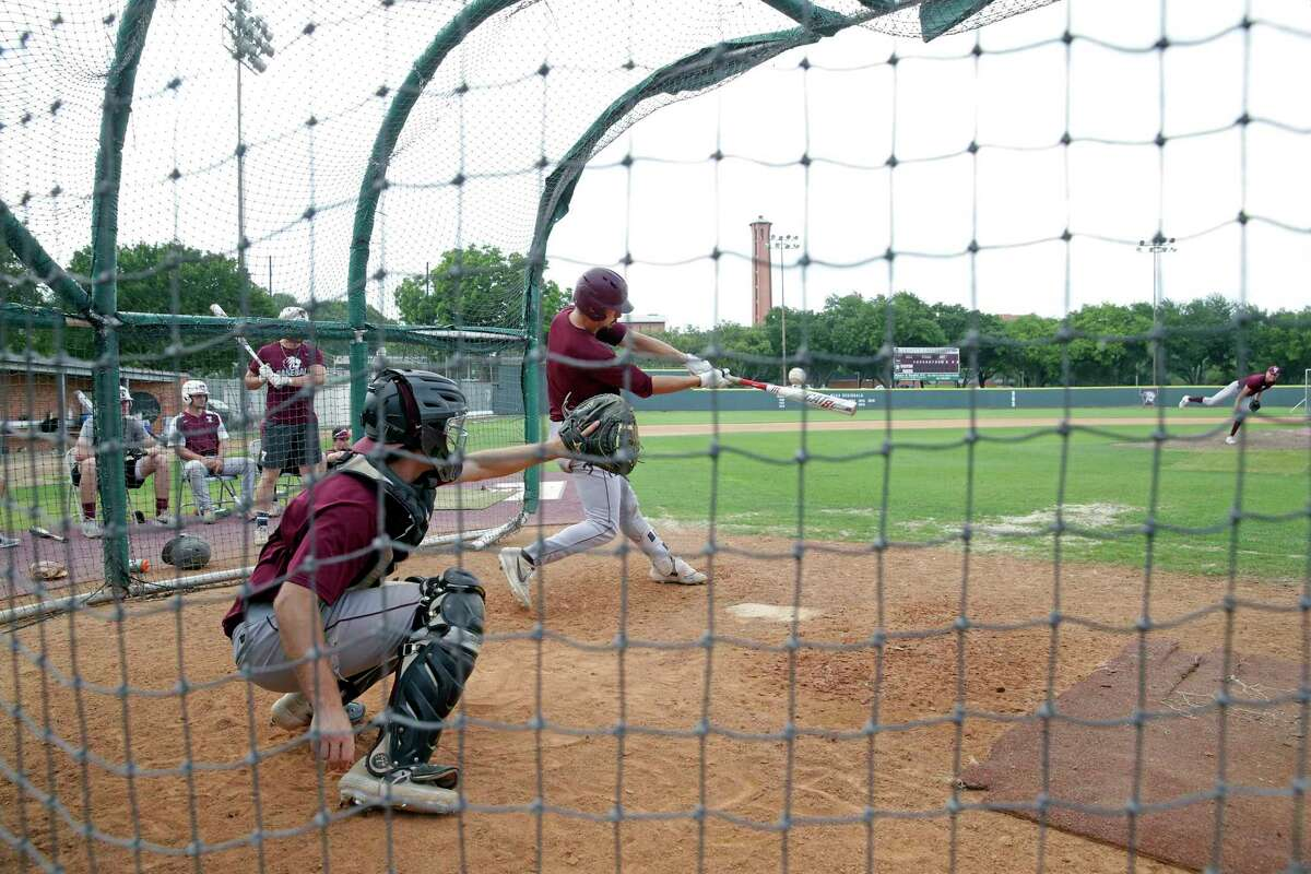 Junior catcher Michael Goodrich takes his turn as the Trinity University baseball team goes through batting practice on May 14, 2019. The university announced Wednesday that the Tigers' athletics seasons will end March 23 in response to the coronavirus.