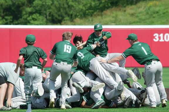 Lutheran South Academy players celebrate after defeating Fort Worth Christian, 11-1, for the TAPPS Division II state baseball championship Wednesday at Crosby High School.