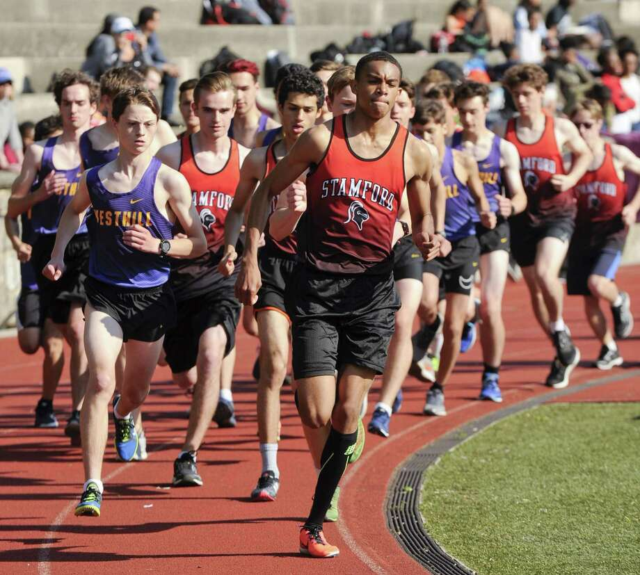 Stamford's Ashton Williams takes the lead at the start of the Boys 1600 meter run during the city track and field meet at Boyle Stadium on May 15, 2019 in Stamford, Connecticut. Williams placed first with a time of 4:38.25. Photo: Matthew Brown / Hearst Connecticut Media / Stamford Advocate