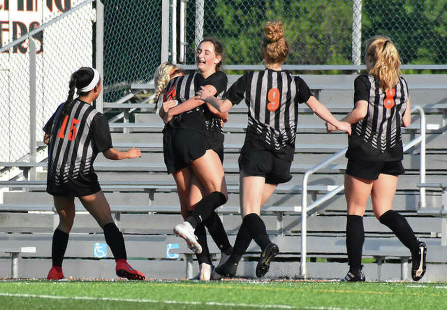 Edwardsville celebrates after Hannah Bielicke scores in the 98th minute against Belleville West on Wednesday. Photo: Matt Kamp/The Intelligencer