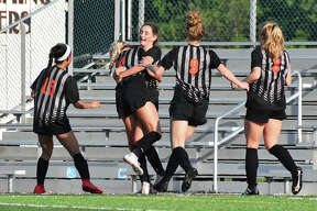 Edwardsville celebrates after Hannah Bielicke scores in the 98th minute against Belleville West on Wednesday.