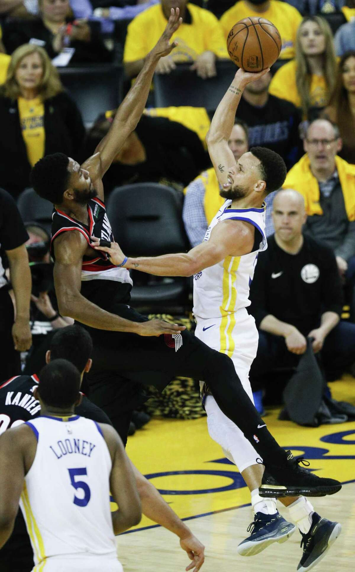 Golden State Warriors Stephen Curry goes up against Portland Trail Blazers Maurice Harkless in the third quarter during game 1 of the Western Conference Finals between the Golden State Warriors and the Portland Trail Blazers at Oracle Arena on Tuesday, May 14, 2019 in Oakland, Calif.