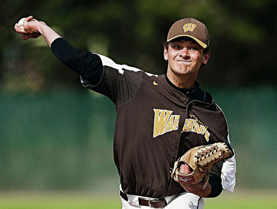 Bay City Western pitcher Adam Randall delivers a pitch against Midland High earlier this season. Photo: Daily News File Photo