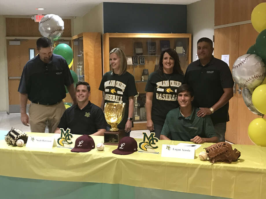 Lee baseball players Noah Harrison (seated left) and Logan Acosta (seated right) signed with Midland College during a ceremony, Wednesday at Lee High School. Photo: Christopher Hadorn