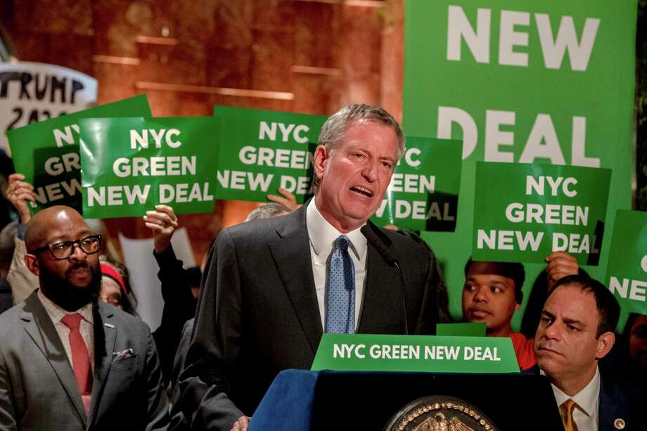 Mayor Bill de Blasio holds a news conference on environmental issues inside Trump Tower in Manhattan, May 13, 2019. De Blasio's appearance here had the feel of a campaign event, as he fought to be heard over hecklers with a ?worst mayor ever? sign and the songs of Tony Bennett. (Hilary Swift/The New York Times) Photo: HILARY SWIFT / NYTNS