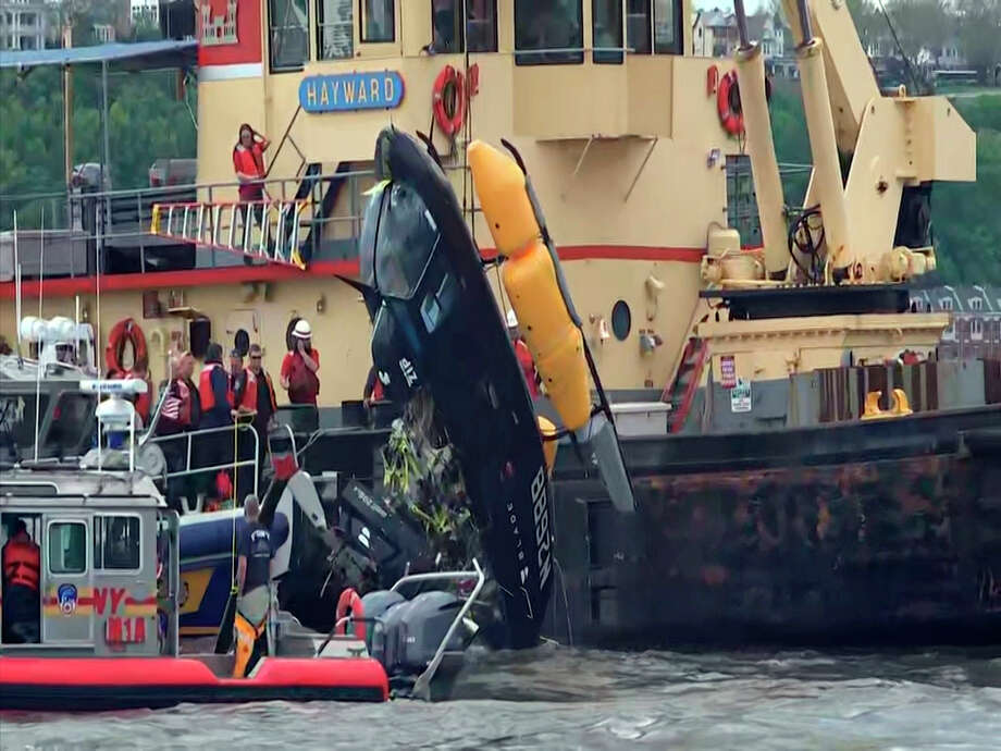 In this image made from video, a crane lifts a helicopter out of the water after it crashed into the Hudson River, Wednesday, May. 15, 2019. in New York. Officials said that the pilot was being treated for a non-life-threatening injury. There were no passengers aboard the aircraft. (AP Photo/Joseph Frederick) Photo: Joseph Frederick / Copyright 2019 The Associated Press. All rights reserved.