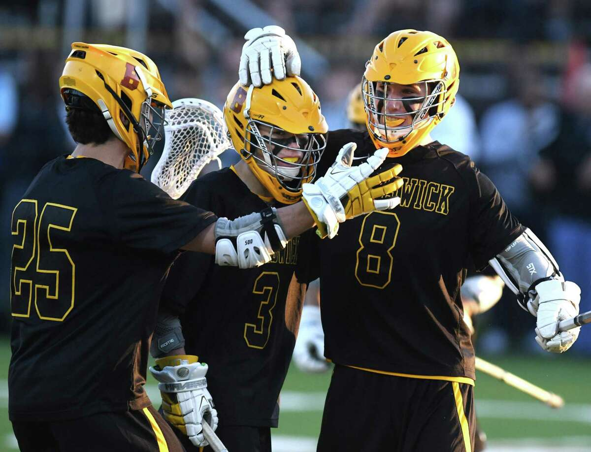 Brunswick's Luke Waters (25), Jeffrey Matthews (3) and Christian Ronda (8) celebrate a goal in the high school boys lacrosse game between the top-ranked CIAC team Darien and the No. 4 nationally-ranked team Brunswick School at Brunswick School in Greenwich, Conn. Wednesday, May 15, 2019.