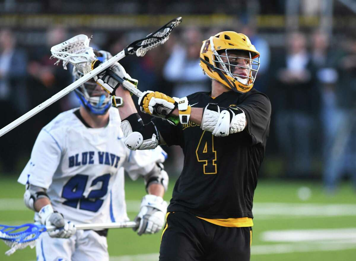 Brunswick's Michael Gottlieb (4) rips a shot in the high school boys lacrosse game between the top-ranked CIAC team Darien and the No. 4 nationally-ranked team Brunswick School at Brunswick School in Greenwich, Conn. Wednesday, May 15, 2019.