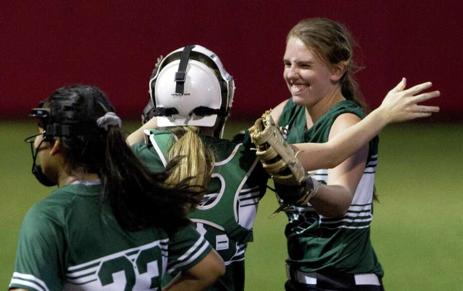 The Woodlands Christian Academy starting pitcher Faith Hanshow (22) reacts toward The Woodlands Christian Academy catcher Mattie Hopkins (28) after defeating First Baptist Christian Academy 5-0 during a TAPPS Division III state semifinal game at The Ballparks in Crosby, Wednesday, May 15, 2019, in Crosby. Photo: Jason Fochtman, Houston Chronicle / Staff Photographer / © 2019 Houston Chronicle