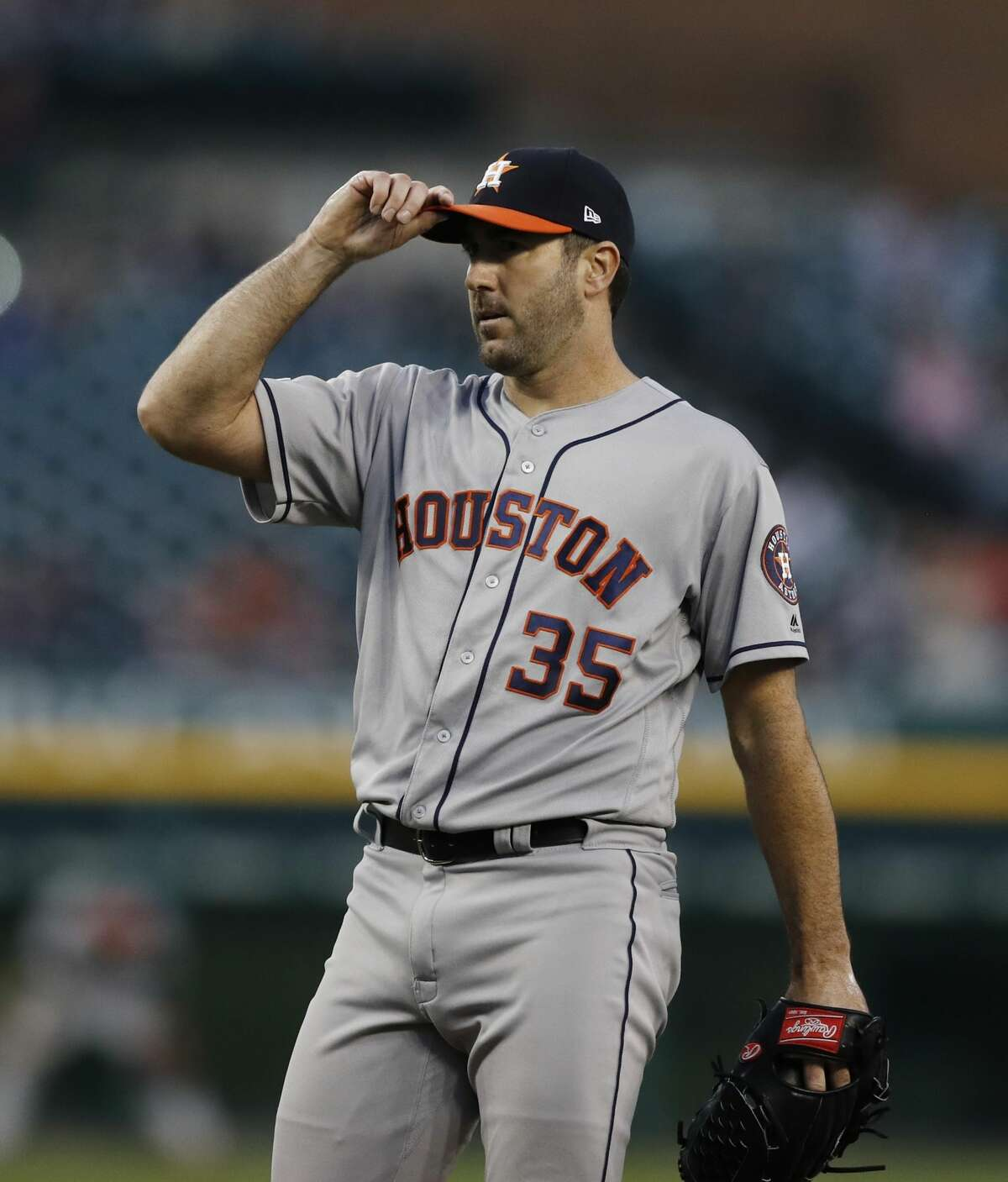 Houston Astros starting pitcher Justin Verlander adjusts his cap after loading the bases during the fifth inning of a baseball game against the Detroit Tigers, Wednesday, May 15, 2019, in Detroit. (AP Photo/Carlos Osorio)