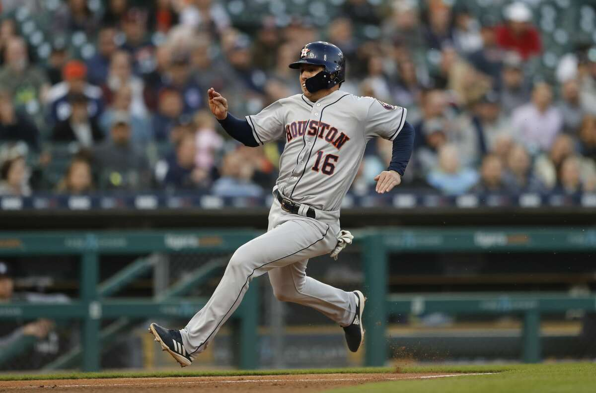 Houston Astros' Aledmys Diaz begins his slide into home plate to score during the fourth inning of a baseball game against the Detroit Tigers, Wednesday, May 15, 2019, in Detroit. (AP Photo/Carlos Osorio)