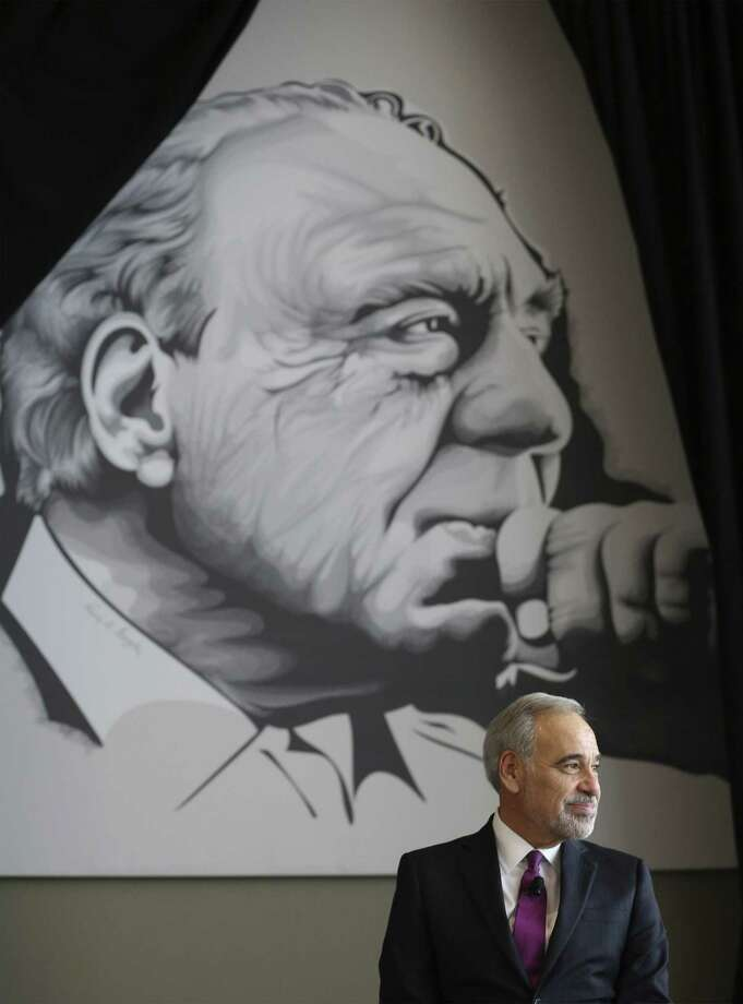 Former Congressional Representative Charlie Gonzalez sits under a mural of his father - one of San Antonio's most iconic politicians - Congressman Henry B. Gonzalez as family, friend and admirers gather at the Convention Center to see the unveiling of Gonzalez's resurrected mural on Wednesday, May 15, 2019. The original mural was painted by artist Ronald Rocha at Estela's Mexican Restaurant on the city's West Side but was painted over by building's new owners. Through an effort by businessman Louis Escareno and many others, a larger than life rendering of the mural was digitally recreated by UTSA adjunct professor and artist Analy Diego and unveiled on Wednesday evening. (Kin Man Hui/San Antonio Express-News) Photo: Kin Man Hui /Staff Photographer / ©2019 San Antonio Express-News