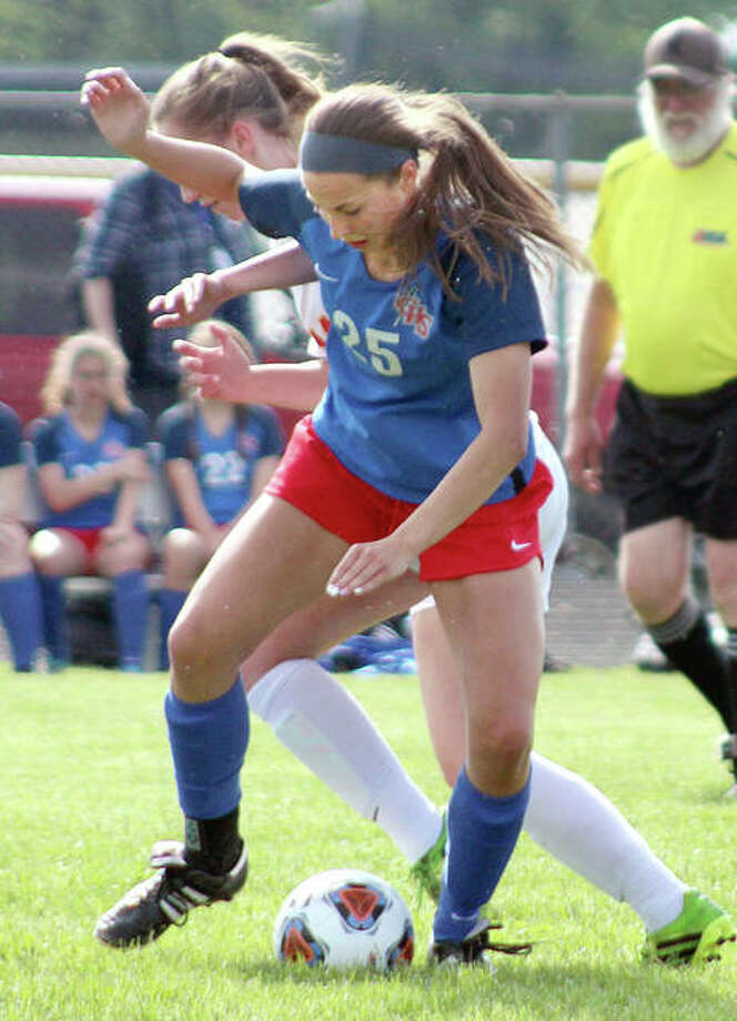 Gabby Marchiori of Carlinville (25) fights for the ball with Reilly Fitzpatrick of Warrensburg-Latham Wednesday at the Litchfield Class 1A Sectional. Photo: Pete Hayes   The Telegraph