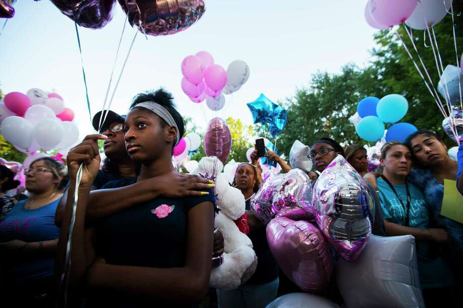Shauntel Huerell embraces her daughter Jazmyn Harrell, 11, at a balloon release ceremony in remembrance of Maleah Davis on Wednesday, May 15, 2019, in Sugar Land. Photo: Marie D. De Jesús, Staff Photographer / © 2019 Houston Chronicle