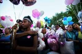 Shauntel Huerell embraces her daughter Jazmyn Harrell, 11, at a balloon release ceremony in remembrance of Maleah Davis on Wednesday, May 15, 2019, in Sugar Land.