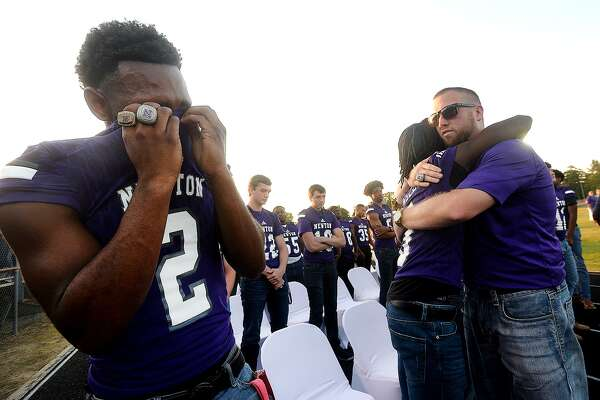 Kevin Watson reacts as new head coach Drew Johnston hugs each of the players following Wednesday's memorial service for 2-time state champion Newton football coach W. T. Johnston at the stadium. Johnston, who for years battled complications from a lung transplant, passed away Saturday. Photo taken Wednesday, May 15, 2019 Kim Brent/The Enterprise