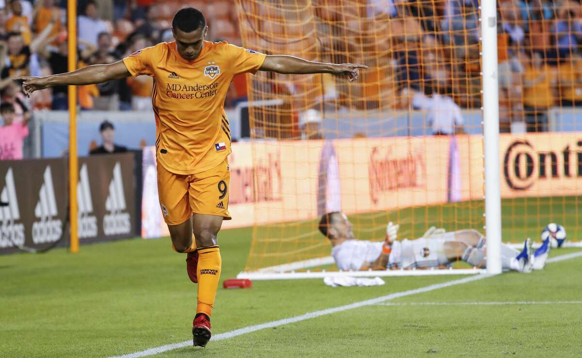 Houston Dynamo forward Mauro Manotas (9) celebrates after scoring a goal on Portland Timbers goalkeeper Jeff Attinella (1) during the first half of a Major League Soccer match at BBVA Compass Stadium on Wednesday, May 15, 2019, in Houston.