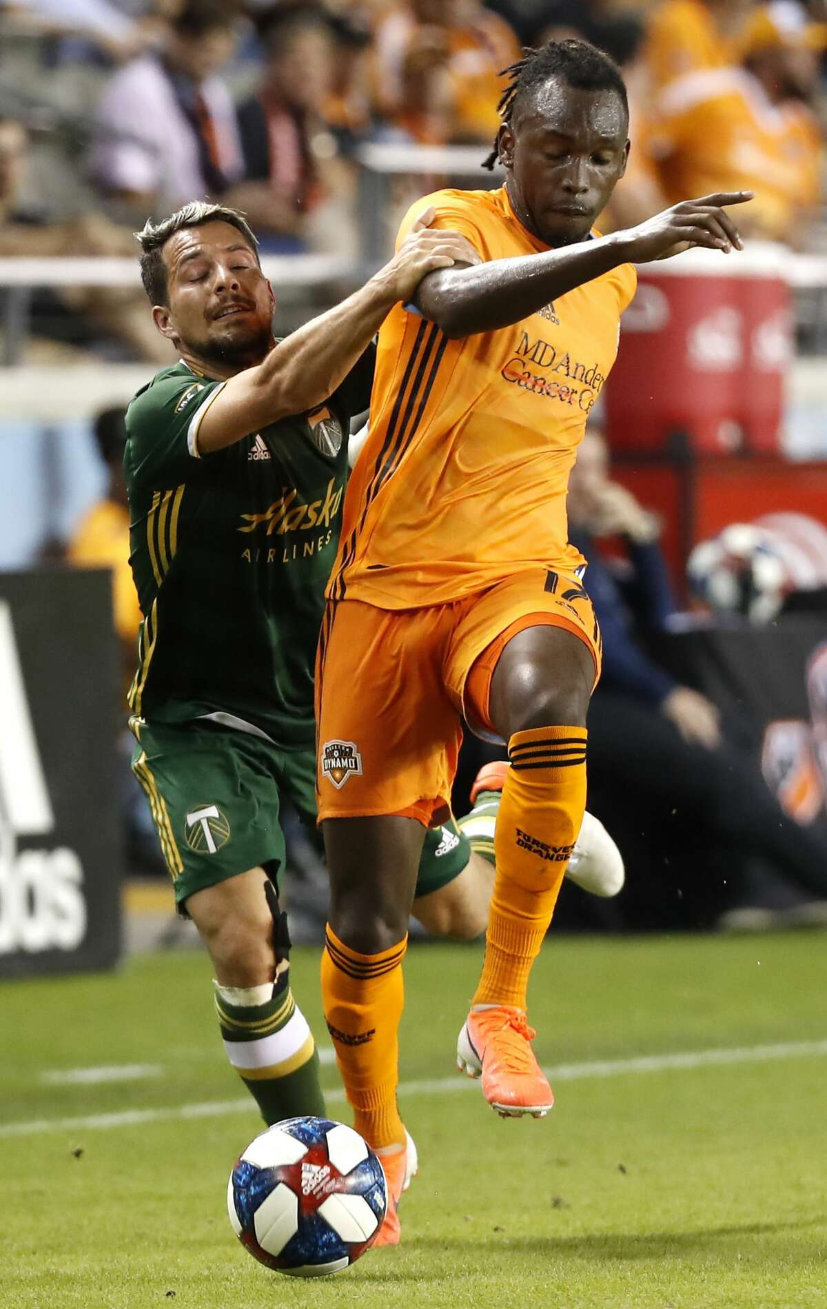Portland Timbers midfielder Sebastian Blanco (10) holds onto Houston Dynamo forward Alberth Elis (17) as Elis takes the ball up the field during the second half of a Major League Soccer match at BBVA Compass Stadium on Wednesday, May 15, 2019, in Houston.