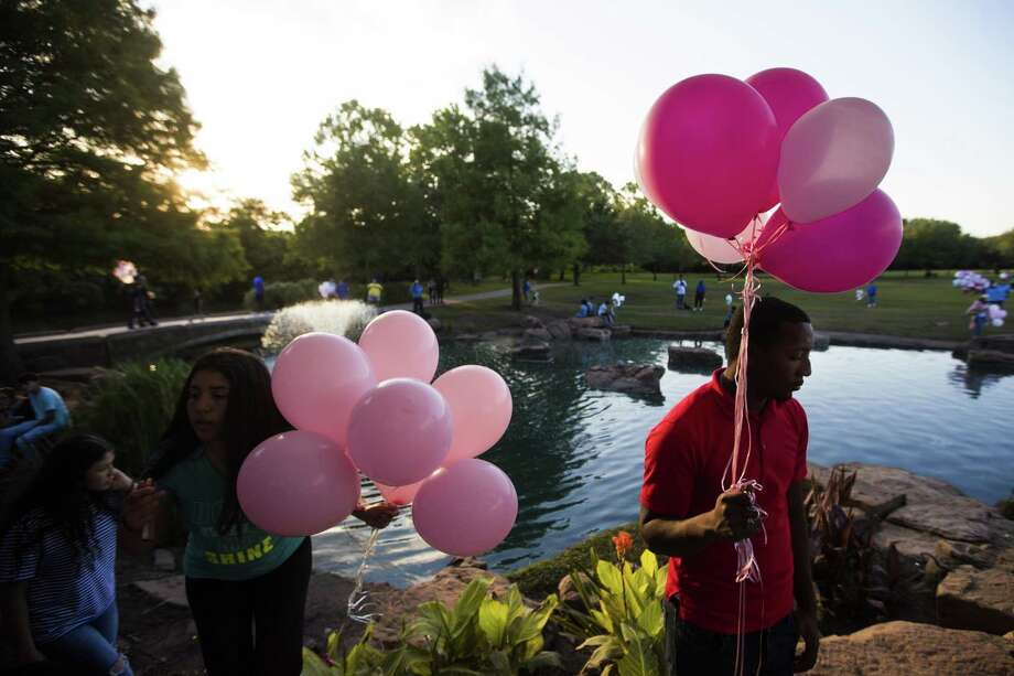 Toran James, 26, brought balloons to the Oyster Creek Park in Sugar Land to join the community in remembrance of Maleah Davis on Wednesday, May 15, 2019, in Sugar Land. Photo: Marie D. De Jesús, Houston Chronicle / Staff Photographer / © 2019 Houston Chronicle