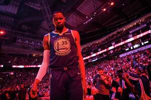 Golden State Warriors forward Kevin Durant (35) prepares for the start of game 4 of the NBA Western Conference Semifinals between the Golden State Warriors and Houston Rockets at the Toyota Center in Houston, Texas, on Monday, May 6, 2019.