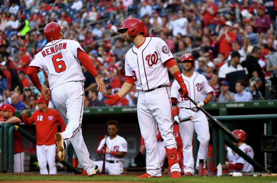 Nationals third baseman Anthony Rendon (6) is congratulated by teammate Brian Dozier after scoring in the first inning of Wednesday's game against the Mets. Rendon went 3-for-4 in Washington's 5-1 victory. Photo: Washington Post Photo By Katherine Frey / The Washington Post
