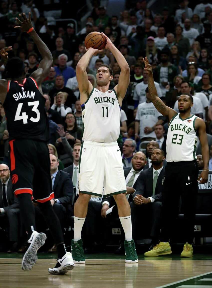 MILWAUKEE, WISCONSIN - MAY 15: Brook Lopez #11 of the Milwaukee Bucks attempts a shot while being guarded by Pascal Siakam #43 of the Toronto Raptors in the third quarter in Game One of the Eastern Conference Finals of the 2019 NBA Playoffs at the Fiserv Forum on May 15, 2019 in Milwaukee, Wisconsin. NOTE TO USER: User expressly acknowledges and agrees that, by downloading and or using this photograph, User is consenting to the terms and conditions of the Getty Images License Agreement. (Photo by Jonathan Daniel/Getty Images)
