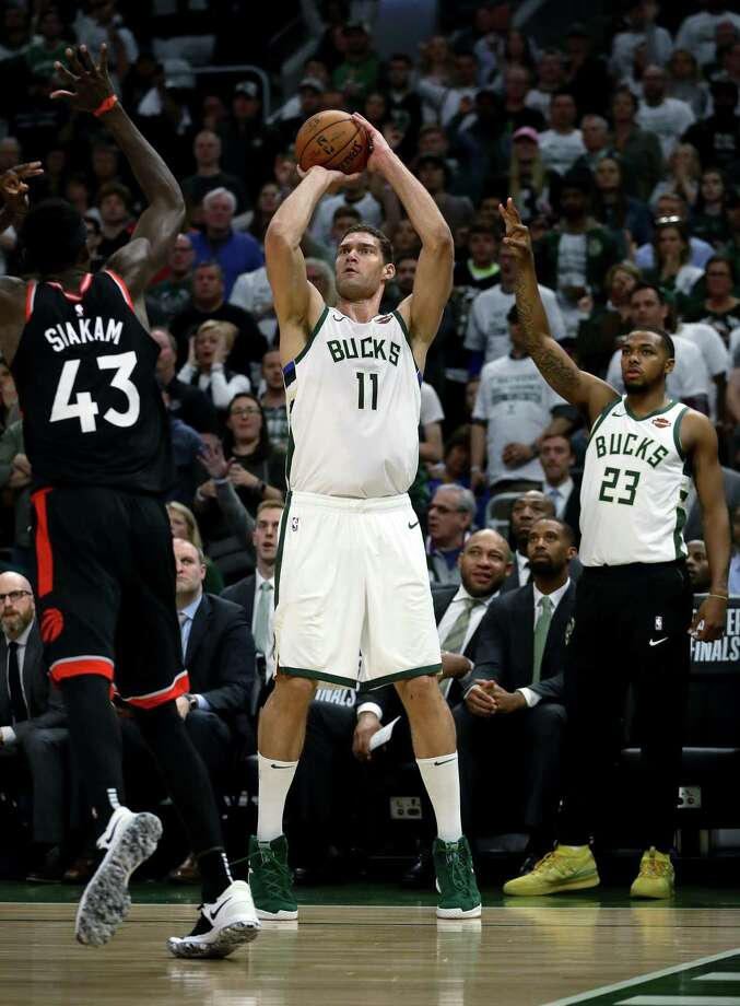 MILWAUKEE, WISCONSIN - MAY 15:  Brook Lopez #11 of the Milwaukee Bucks attempts a shot while being guarded by Pascal Siakam #43 of the Toronto Raptors in the third quarter in Game One of the Eastern Conference Finals of the 2019 NBA Playoffs at the Fiserv Forum on May 15, 2019 in Milwaukee, Wisconsin. NOTE TO USER: User expressly acknowledges and agrees that, by downloading and or using this photograph, User is consenting to the terms and conditions of the Getty Images License Agreement. (Photo by Jonathan Daniel/Getty Images) Photo: Jonathan Daniel / 2019 Getty Images