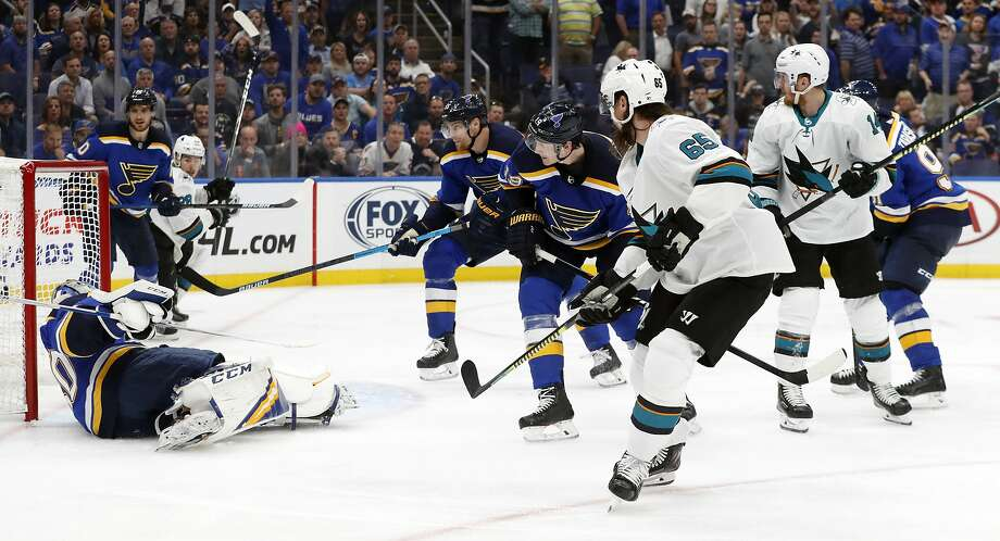 San Jose Sharks defenseman Erik Karlsson (65), of Sweden, scores the winning goal past St. Louis Blues goaltender Jordan Binnington (50) during overtime in Game 3 of the NHL hockey Stanley Cup Western Conference final series Wednesday, May 15, 2019, in St. Louis. The Sharks won 5-4 to take a 2-1 lead in the series. (AP Photo/Jeff Roberson) Photo: Jeff Roberson, Associated Press