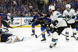 San Jose Sharks defenseman Erik Karlsson (65), of Sweden, scores the winning goal past St. Louis Blues goaltender Jordan Binnington (50) during overtime in Game 3 of the NHL hockey Stanley Cup Western Conference final series Wednesday, May 15, 2019, in St. Louis. The Sharks won 5-4 to take a 2-1 lead in the series. (AP Photo/Jeff Roberson)