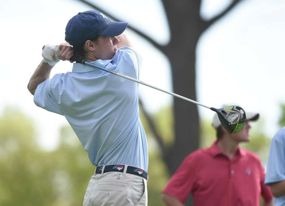 Darien's Henry Sparkman watches the flight of the ball while teeing off against rival New Canaan in a boys golf match at the Country Club of New Canaan on May 15, 2019. Photo: Dave Stewart / Hearst Connecticut Media / Hearst Connecticut Media