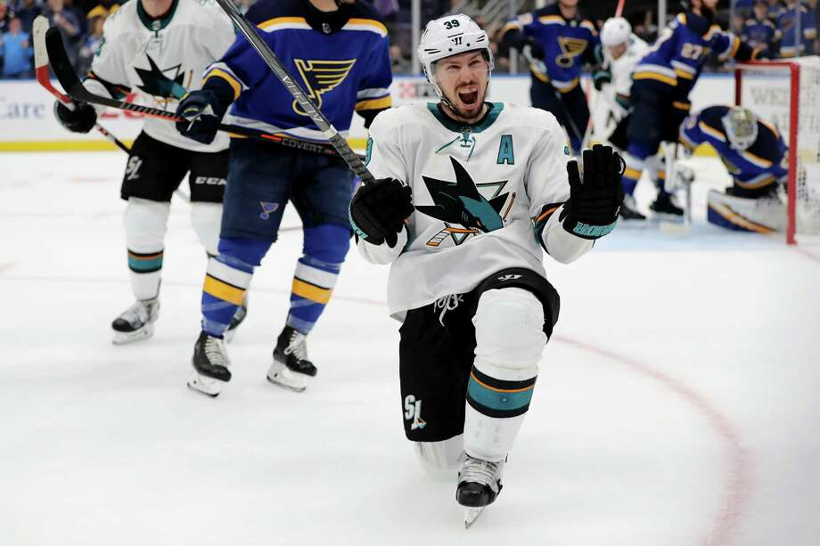 ST LOUIS, MISSOURI - MAY 15: Logan Couture #39 of the San Jose Sharks celebrates after scoring a goal on Jordan Binnington #50 of the St. Louis Blues during the third period in Game Three of the Western Conference Finals during the 2019 NHL Stanley Cup Playoffs at Enterprise Center on May 15, 2019 in St Louis, Missouri. (Photo by Elsa/Getty Images) Photo: Elsa / 2019 Getty Images