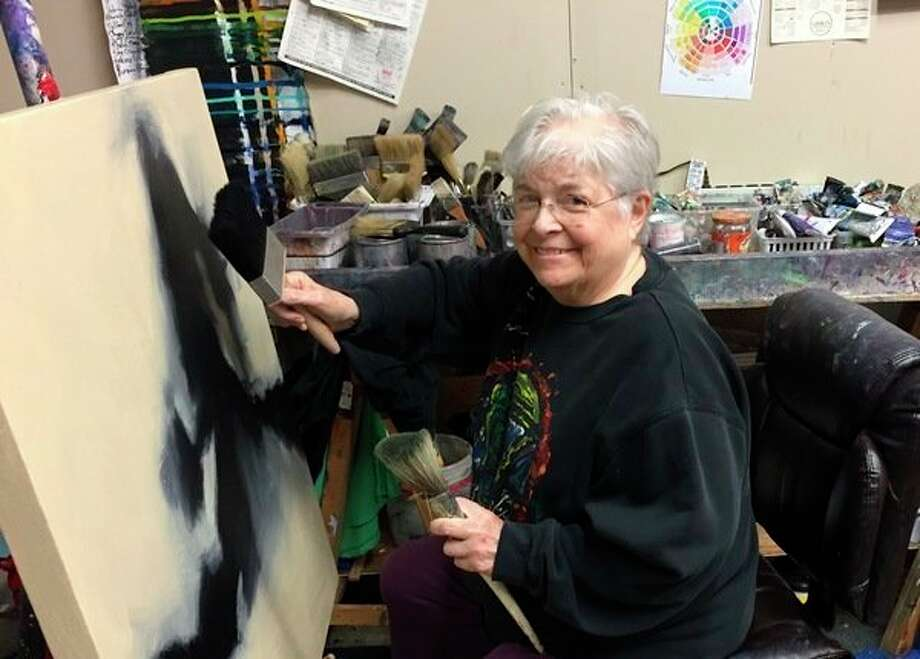 Kathy Kaunitz Jones paints at an easel. She was Creative 360's first art teacher, and she continued to teach at the Midland Center for the Arts until 2016 when she retired to paint full time. (Photo provided)