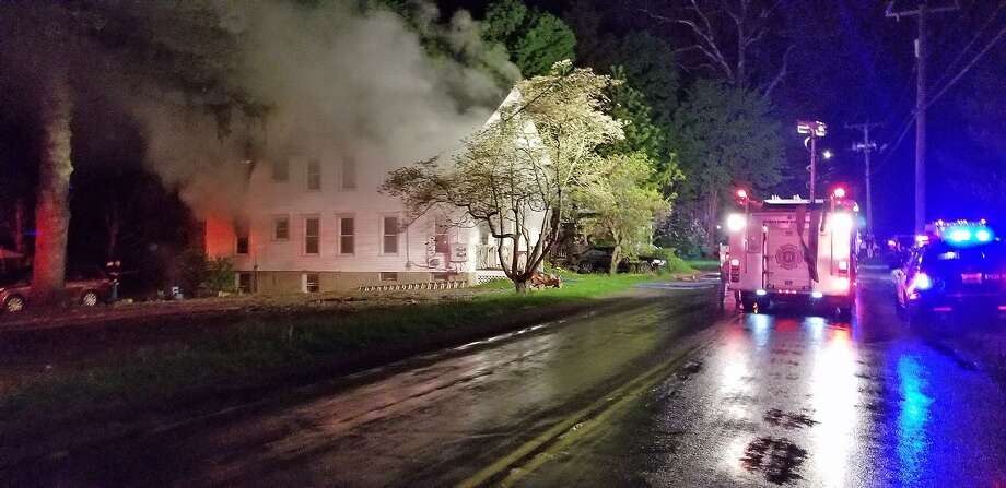 Several people were injured in an early morning fire in a multi-family house on Housatonic Avenue in New Milford on Thursday, May 16, 2019. Photo: Bernie Meehan /Contributed Photo