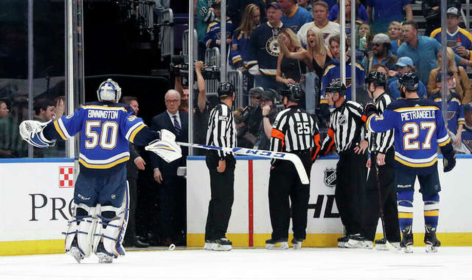 Blues goaltender Jordan Binnington (50) and defenseman Alex Pietrangelo (27) argue against the winning goal by the San Jose Sharks in overtime of Game 3 of the Stanley Cup Western Conference finals Wednesday in St. Louis. The Sharks won 5-4 to take a 2-1 lead in the series. Photo: AP