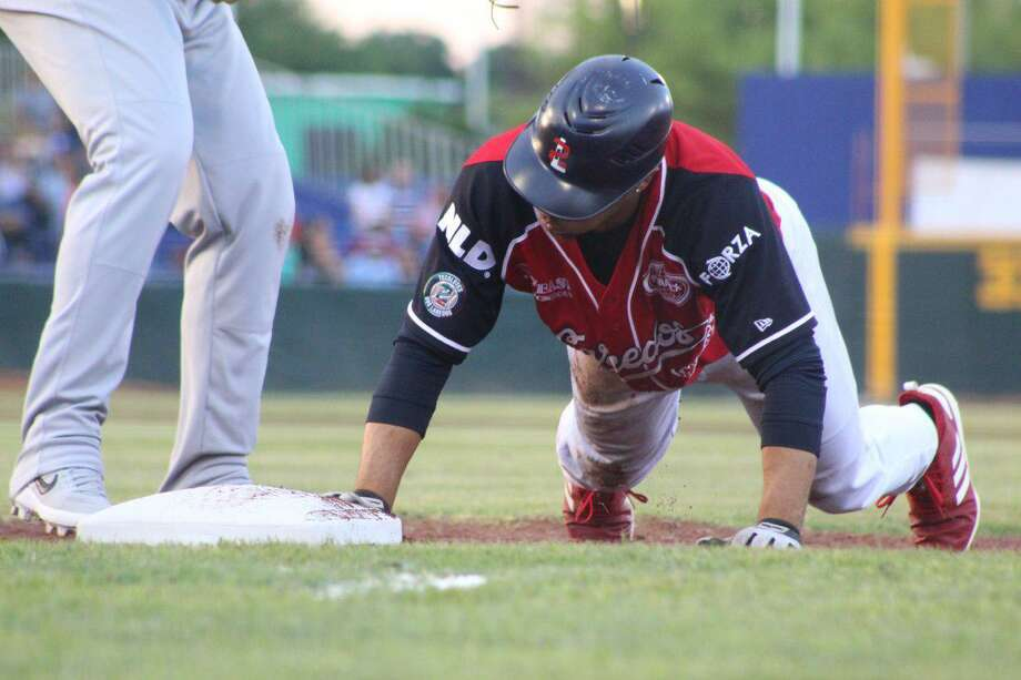 Center fielder Johnny Davis and the Tecolotes lost 4-3 at Uni-Trade Stadium against last-place Durango Saturday. Davis was 2-for-4 with two runs, and he extended his league lead in stolen bases to 33 with two more. Photo: Courtesy Of The Tecolotes Dos Laredos, File