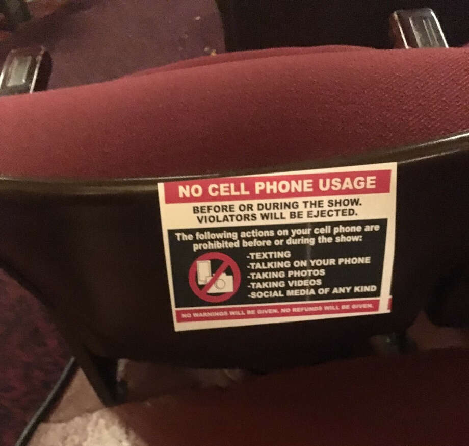 In a first for the Palace Theatre, signs prohibiting cellphone use during a performance were affixed to the end of every row of seats in addition to being posted on theater doors and walls. The notices were required by comedian Aziz Ansari, who performed at the Palace on Wednesday night. Photo: Steve Barnes/Times Union