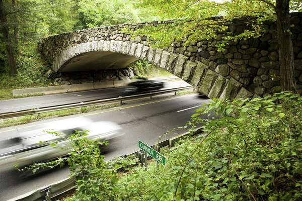 Cars travel north and south on the Merritt Parkway under the Guinea Road Bridge in Stamford.