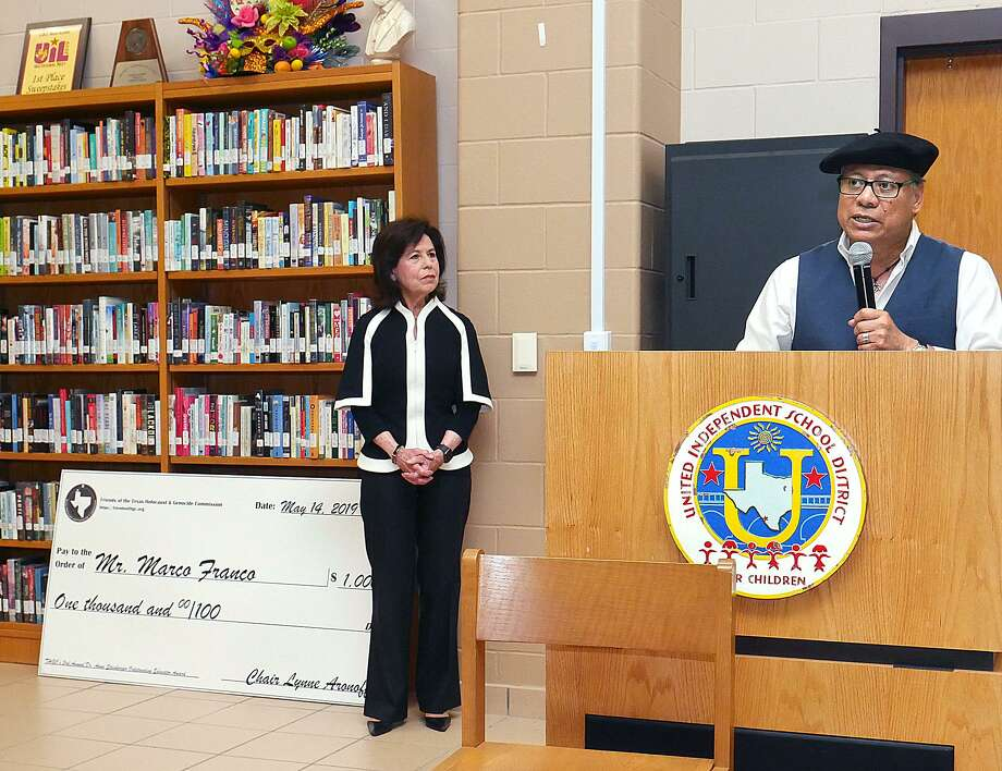 "Lynne Aronoff, Commission Chair, listens as United High School ESL teacher Marco Franco speaks after being awarded the Dr. Anna Steinberger Outstanding Educator Award by The Texas Holocaust & Genocide Commission at the United High School library Tuesday. Franco was presented with a check for $1,000 and a copy of the book ""The Texas Liberators: Veteran Narratives from World War II."" Photo: Cuate Santos /Laredo Morning Times / Laredo Morning Times"