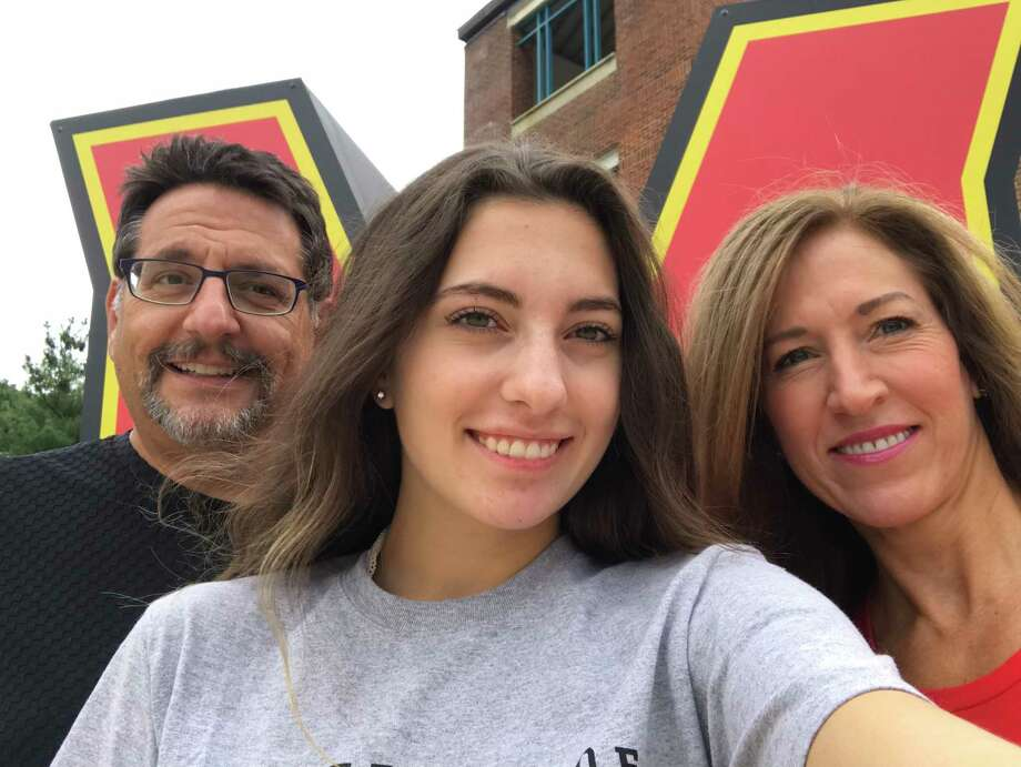 Olivia Paregol takes a selfie with her parents, Ian and Meg, at the University of Maryland in September 2018. Photo: Courtesy Of Paregol Family. For Use Only With MARYLAND-MOLD. / Handout