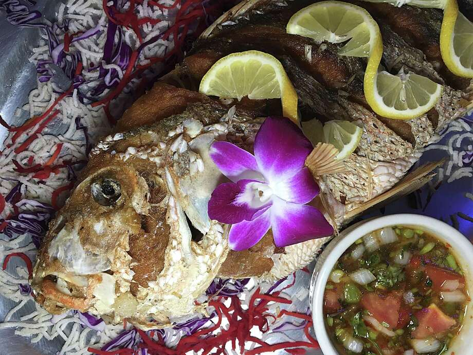 A whole fried snapper is a specialty at Tong's Thai Restaurant. Photo: Mike Sutter /Staff