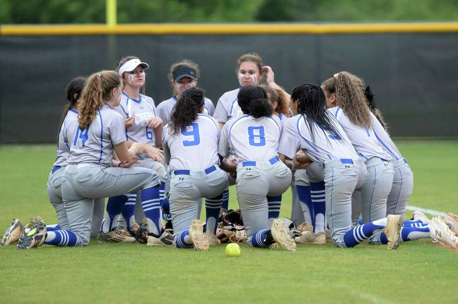 The Cy Creek Cougars prepare for their Class 6A Region III playoff softball game with the Ridge Point Panthers on Wednesday, May 1, 2019 at Mayde Creek High School, Katy, TX. Photo: Craig Moseley, Houston Chronicle / Staff Photographer / ©2019 Houston Chronicle