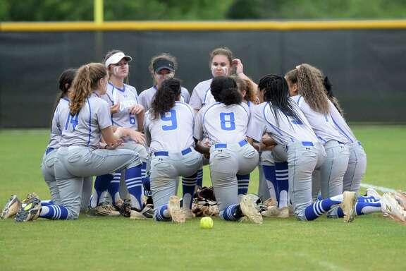 The Cy Creek Cougars prepare for their Class 6A Region III playoff softball game with the Ridge Point Panthers on Wednesday, May 1, 2019 at Mayde Creek High School, Katy, TX.