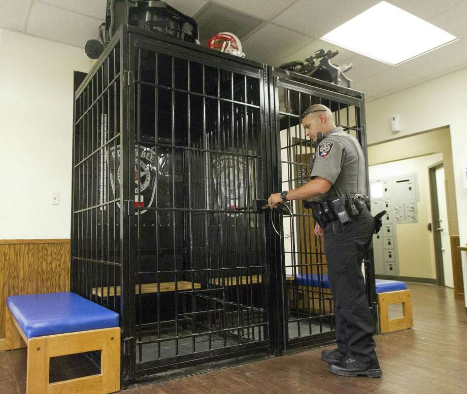The holding cells, repurposed from once soda dispensers, are seen at the Montgomery County Precinct 4 Constable's Office, Thursday, April 18, 2019, in New Caney. Photo: Jason Fochtman, Houston Chronicle / Staff Photographer / © 2019 Houston Chronicle