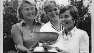 Sara Jane Stubler, right, accepts Northeaster Women's Association Medal Play Championship trophy from Eli Reynolds (tournament chairman Undated (left), and Elaine Savers, 1973 champion (center). Undated (Fred McKinney/Times Union Archive)