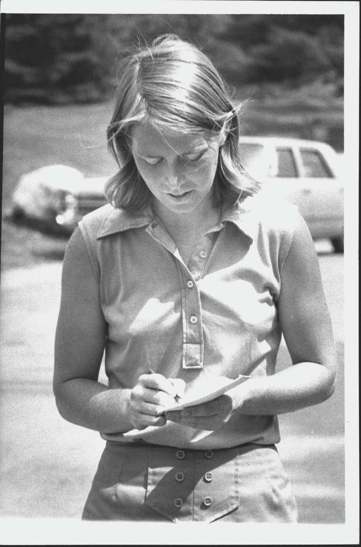 Sharyn Heliseva checks scorecard during round of golf in New York. Undated (Times Union Archive)