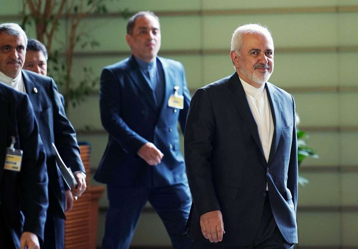 Iranian Foreign Minister Mohammad Javad Zarif (R) walks to meet Japanese Prime Minister Shinzo Abe at Abe's official residence in Tokyo on May 16, 2019. (Photo by Eugene Hoshiko / POOL / AFP)EUGENE HOSHIKO/AFP/Getty Images
