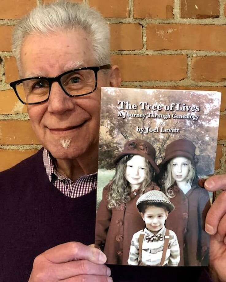 "Joel Levitt poses with his new book, ""The Tree of Lives."" Photo: Contributed Photo /"