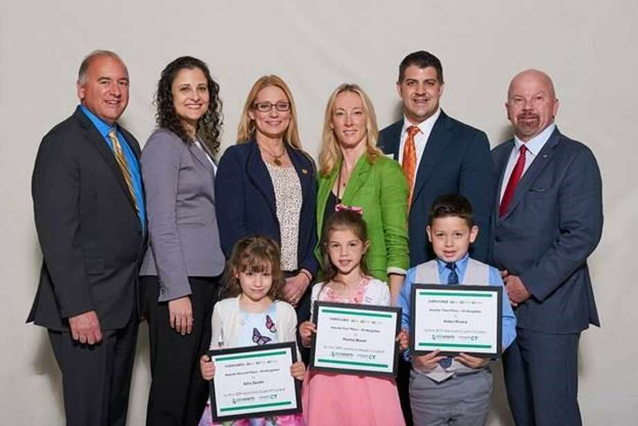 Torrington student Ailis Devlin, left, pictured alongside other kindergarten finalists, with Ron Araujo, Eversource; Mary Sotos, DEEP Deputy Commissioner, State Reps. Michelle Cook, Terry Woods, Gary Turco, and Joe Gresko, won 2nd place in the kindergarten category in the 14th eesmarts student contest. Photo: Contributed Photo /