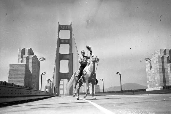 An envelope titled freak first day crossings of the Golden Gate Bridge with the Marin Headlands in the background sometime before opening, May 27, 1937 .. This could be the first person to cross the bridge on a horse.